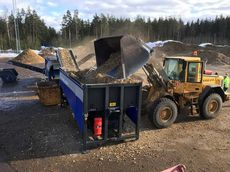 Loading pre-shredded waste wood into the TAKER HOOK